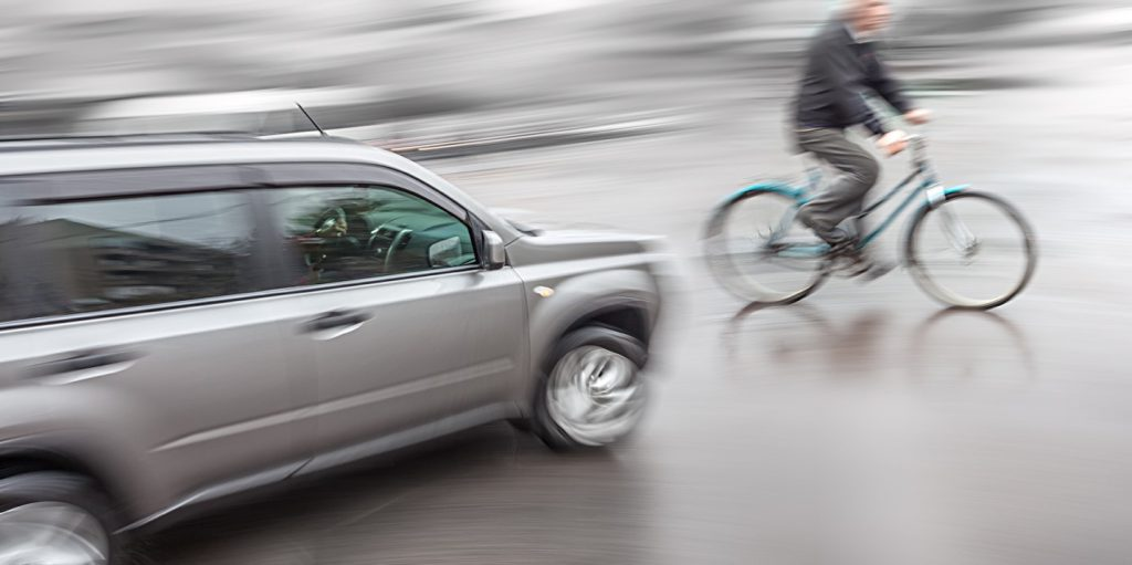 Car About to Hit Cyclist