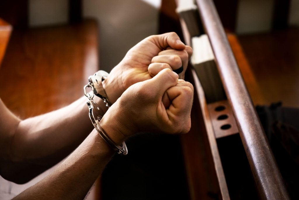 Male with a Handcuffed in the Church